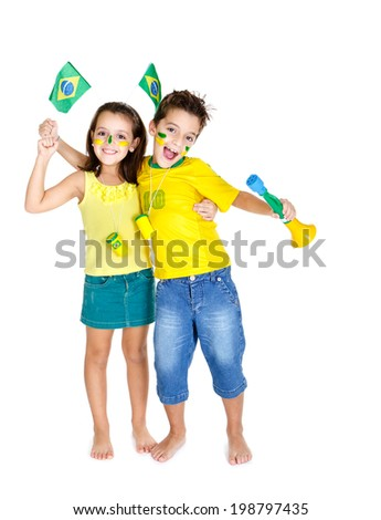 Brazilian fans Kids celebrating and supporting Brazil with vuvuzelas and wearing the colors of Brazil. #198797435