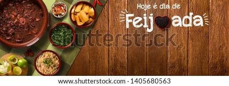 "Brazilian Feijoada Food. Outdoor format. Written ""Today is Feijoada's day"" in portuguese."