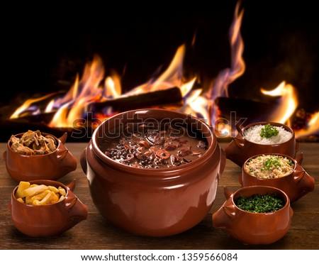 Brazilian Feijoada Food with fire background.