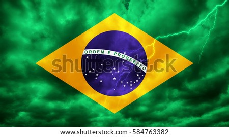 Brazilian flag against dark sky, clouds and lightning #584763382