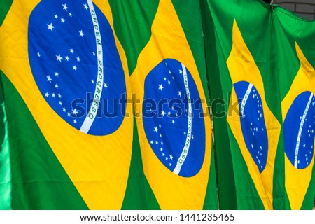 Brazilian flag hanging for sale on political public act