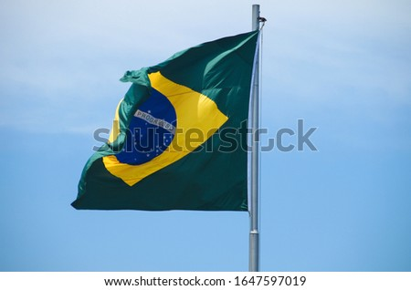 Brazilian flag in a blue sky