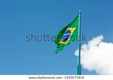 Brazilian flag on a sunny day