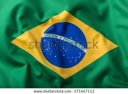 Brazilian flag with text Ordem E Progresso.