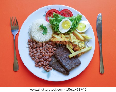 Brazilian food dish with orange background