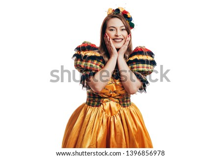 Brazilian girl wearing typical clothes for the Festa Junina - June festival
