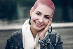 Brazilian hipster girl with beautiful smile and short pink hair. Positive pretty woman outdoors. Portrait
