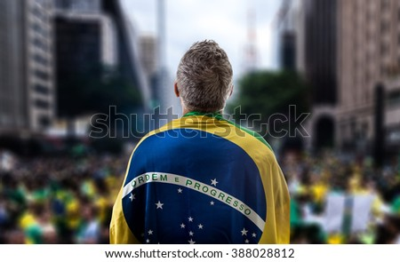 Brazilian holding the flag of Brazil in Paulista Avenue #388028812