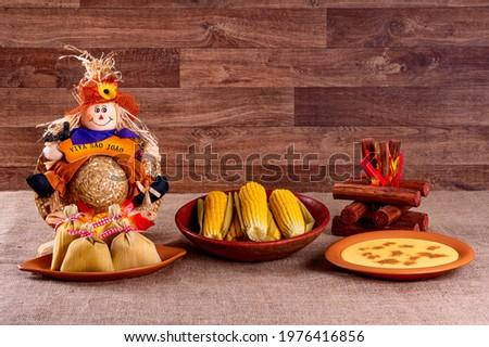 Brazilian june party. Typical foods of the June festival. hominy, boiled corn, corn cake, popcorn, broccoli, paçoca, genipapo and peanuts. It is written: 'Viva São João' in Portuguese. Сток-фото ©