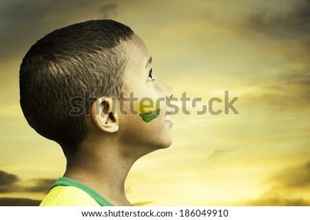 Brazilian little boy looks to the beautiful sky