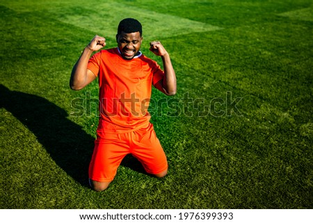 brazilian man goalkeeper catches the ball in the stadium during a football training Photo stock ©