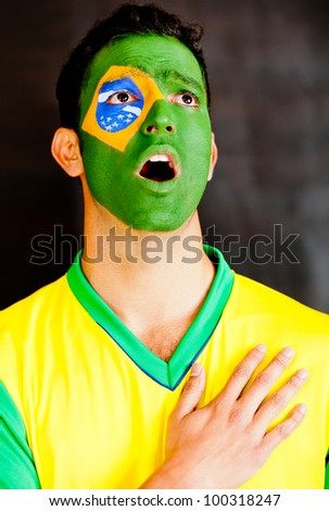 Brazilian man singing the National anthem