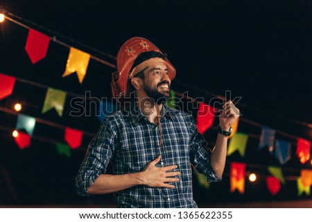 Brazilian man wearing traditional clothes for Festa Junina - June festival