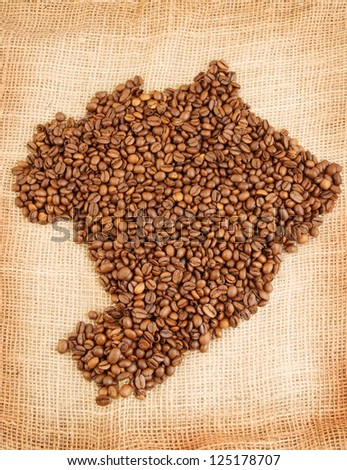 Brazilian map made out of coffee beans on jute background