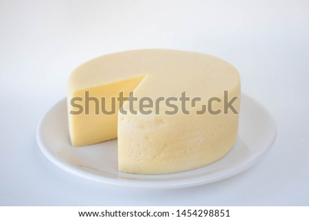 Brazilian minas cheese on a plate on a white background