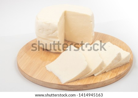 Brazilian Minas Cheese Sliced on white background. Fresh Cheese