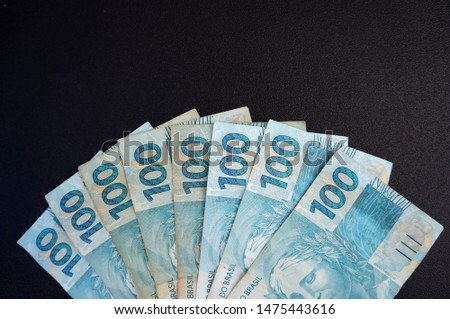 Brazilian money.  Brazilian currency real  on black background.