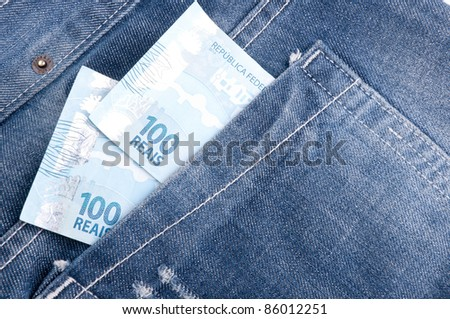 Brazilian money in the pocket of his jeans.