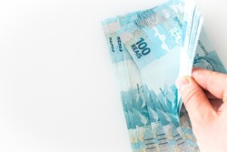 Brazilian money. Lots of 100 Real Banknotes, Counting, Economic Concept, White background, Place for text