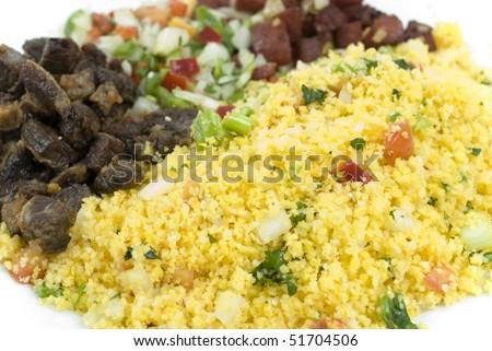 Brazilian northeast Food - Couscous Farofa with dry meat and vinaigrette salad.