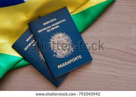 Brazilian passport on Brazilian flag