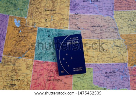 Brazilian passport on United States map. Tourism. Tourism in America. #1475452505