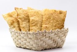 Brazilian pastry, traditional pasta called meat pastry on isolated on white background, copyspace