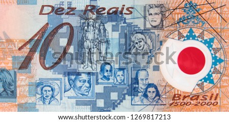 Brazilian people on Brazilian 10 real (2000) banknote. Brazil money currency close up. #1269817213