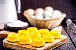 Brazilian quindim is a sweet made from egg yolk, sugar and grated coconut. Corresponds to the Portuguese recipe known as brisa-do-Lis, using grated coconut or almond.