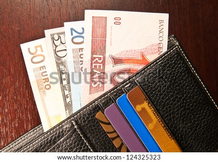 Brazilian real, euro and dollars in wallet