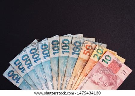 Brazilian real notes. Brazilian currency. Real. Brazilian money. Money from Brazil on black background.