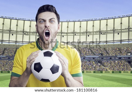 Brazilian soccer player celebrates with the fans on the stadium. Can be used as Australian uniform too.