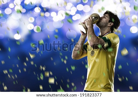Brazilian soccer player, celebrating the championship with a trophy in his hand, on a blue background.