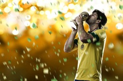 Brazilian soccer player, celebrating the championship with a trophy in his hand, on a yellow background.