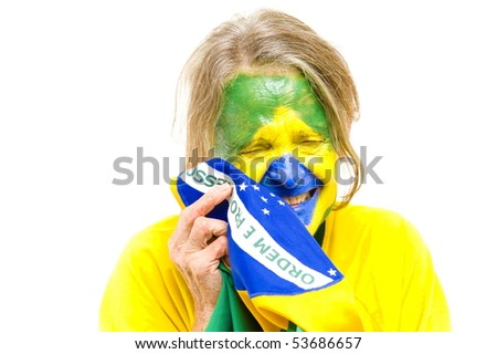 Brazilian sport fan holding a Brazilian Flag and Crying . - stock photo