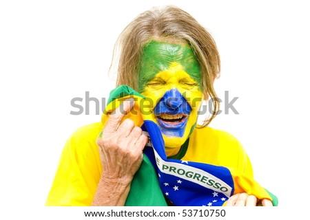 Brazilian sport fan holding a Brazilian Flag and Crying .