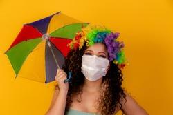 Brazilian wearing carnival Costume. Flu epidemic, protection against virus. Covid-19, coronavirus, carnival concept