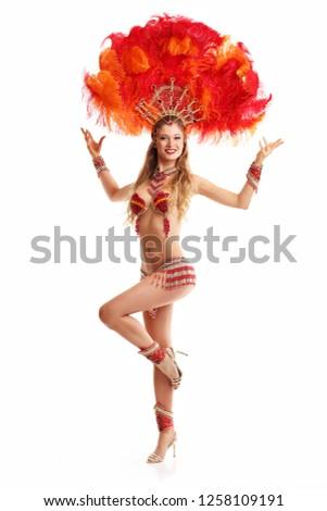 Brazilian woman posing in samba costume over white background