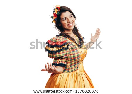 Brazilian woman wearing typical clothes for the Festa Junina dancing isolated on white background