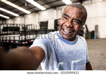 Brazilian Worker Taking a Selfie