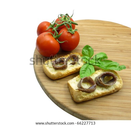 Bread and anchovies - stock photo