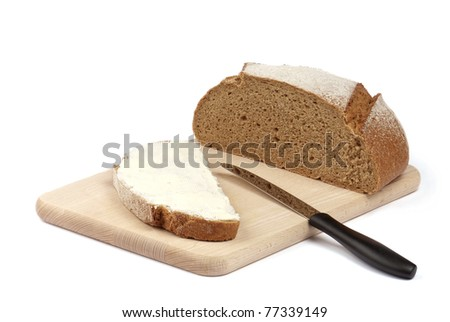 bread and butter on the wooden board isolated on white