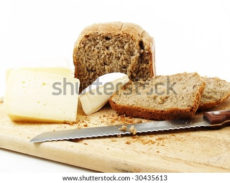 bread and different cheeses on a white background