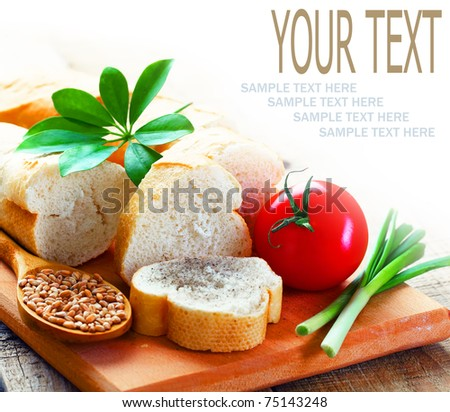 Bread  and  vegetables  on a white background with space for  text