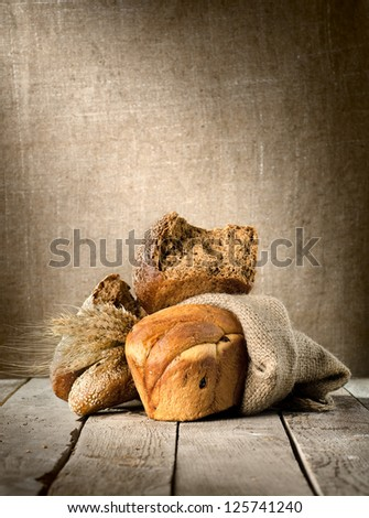 Bread assortment on background of the old canvas