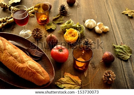 Bread,candles and fall leaves.image of Italian food.