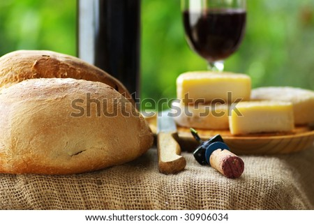 Bread, cheese and red wine.