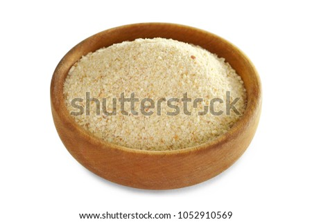 Bread crumbs in wooden bowl isolated on white background