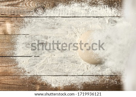 Bread dough stacked on old rustic boards Stock photo ©