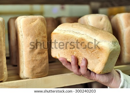 Bread in the man hands Bakery Stocks bread Manufacture of rusks. A loaf of bread in the hand. Manual production of bakery products. Bread by human hands. Man and bread The man on the bread production1